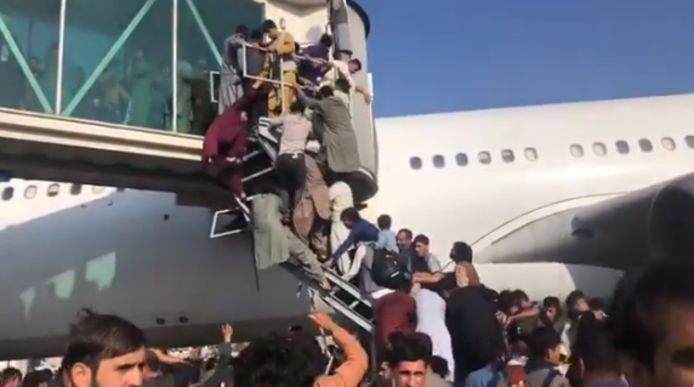 Thousands of Afghans have breached the runway in an attempt to flee their country after the Taliban seized power.