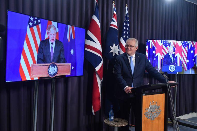 Australian Prime Minister Scott Morrison with Boris Johnson (left) and Joe Biden on screens behind him, announcing the new Oaks Agreement.  Environmental Protection Agency's photo