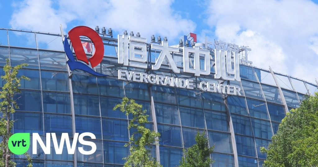 Chinese real estate developer Evergrande, facing deep financial trouble, pays real estate investors