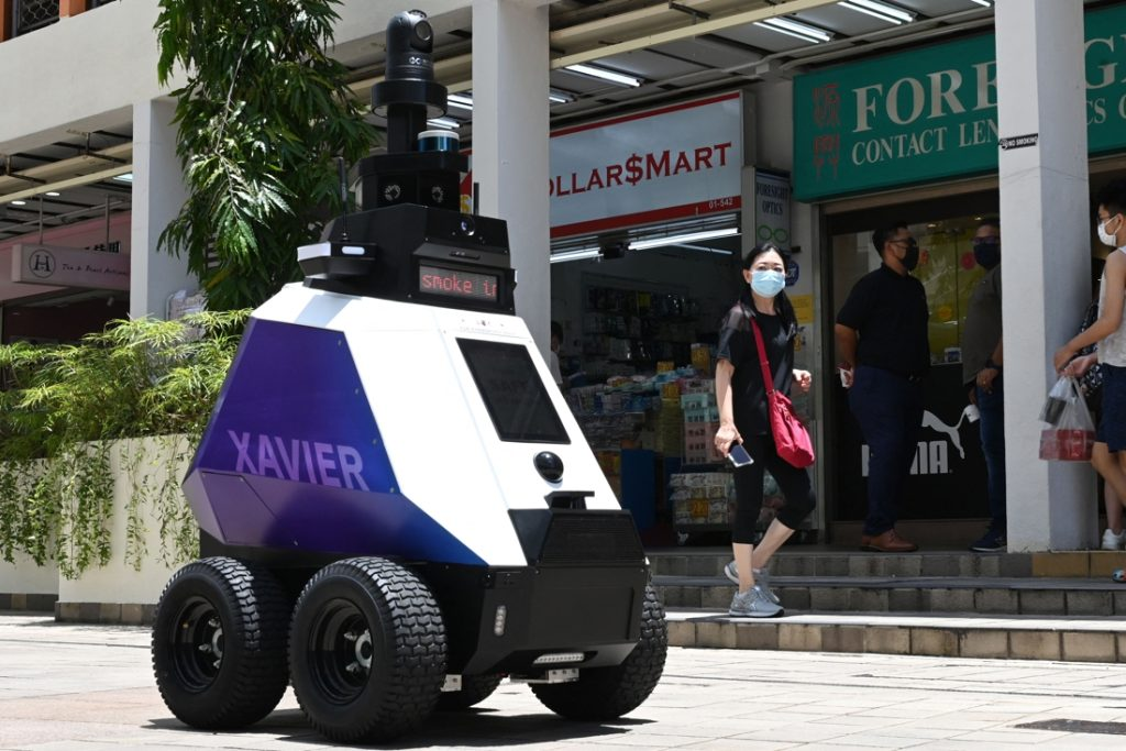 Here, robotic policeman Xavier roams the streets to maintain order...