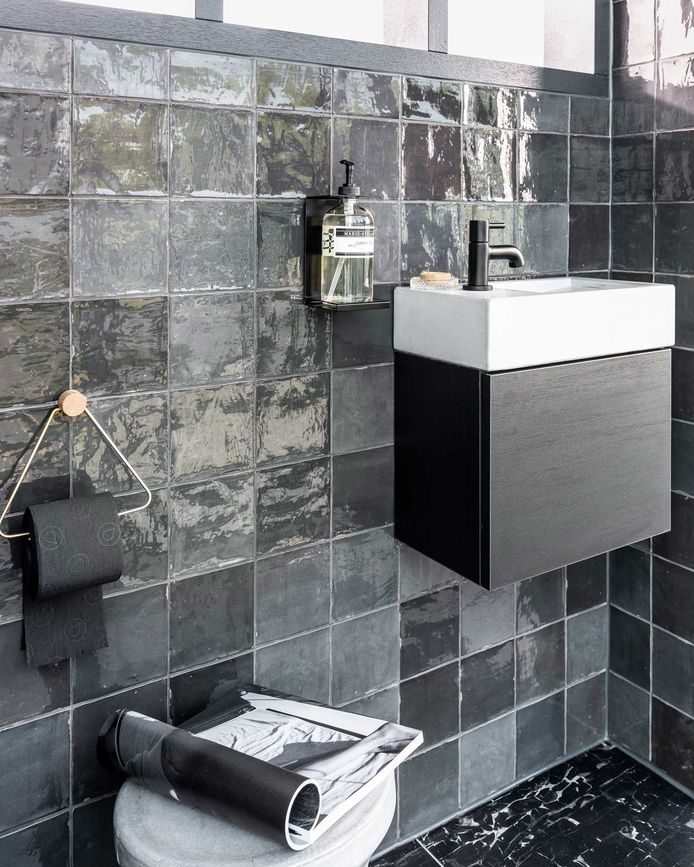 Black toilet accessories provide a timeless industrial look.